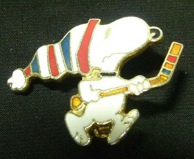 "Peanuts Snoopy With Hockey Stick Pin-back Charm On Metal 1-1/4"" x 1"" x 1/16"""
