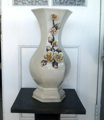 antique porcelain vase with coloured flowers, made in Italy