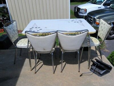 Vintage 1950's formica and  chrome table with 4 chairs
