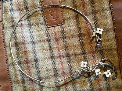 elegant neck piece with chrystal centred flowers and amethyst and hammered silve
