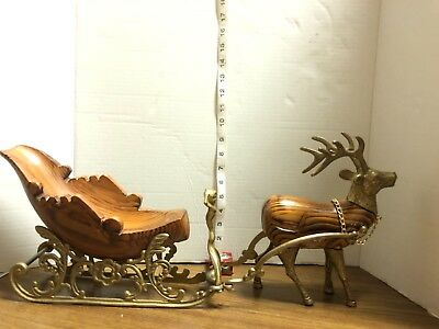 Christmas sleigh with carved wood and brass reindeer