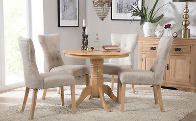 Kingston Round Oak Dining Room Table And 4 Bewley Fabric Chairs Set
