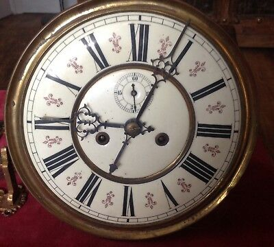 An 8 Inch Porcelain Fleur De Leys Dial Double Weight Vienna Wall Clock Movement