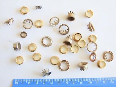 Lot of vintage used and unused clock dial grommets Key hole Spare parts