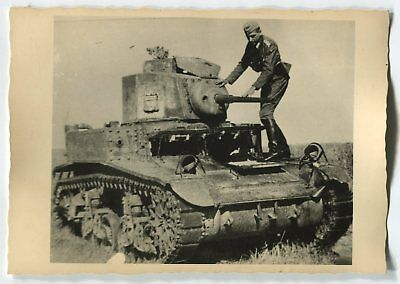 Wwii Photo From Archive: German Soldier On Destroyed American M3 Stuart Tank