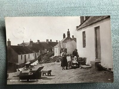Auchmithie Fishing Village Street scene with locals looking on Nr Arbroath