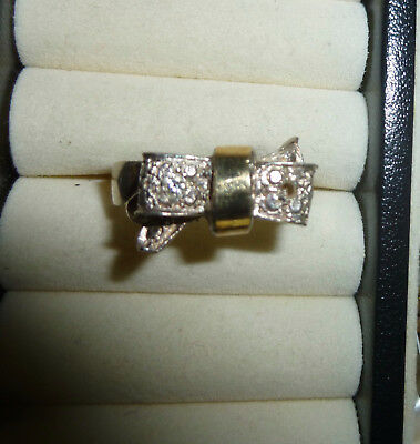 FUN TWO-TONE RHINESTONE BOW RING, missing rhinestone(s)