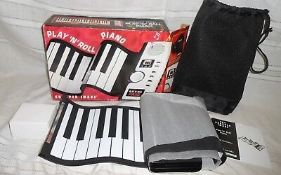 New in the Box Sharper Image Play 'N' Roll Piano Electronic Keyboard