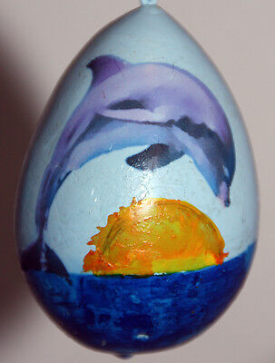 Easter egg, garden or Christmas ornament with dolphin