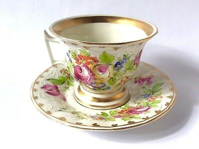 Limoges tea cup and saucer, handpainted & piped enamel with gilt and flowers