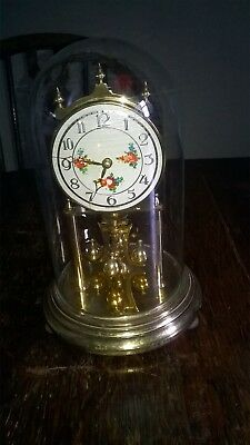 VINTAGE ANNIVERSARY CLOCK. GLASS DOME. APPROX 9 ins TALL