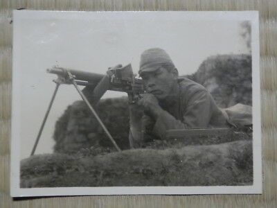 WW2 Japanese Picture of the army soldier who kept Type 11 light machine gun.Good