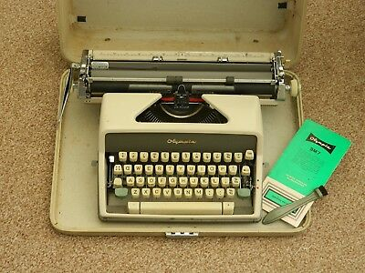 vintage Olympia sm7 portable typewriter and case