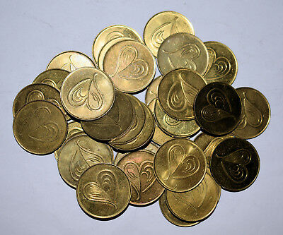 15. Lot Of 34 Brass Toned Tokens With Artistic Heart Shapes On Them