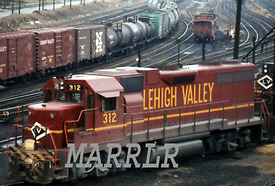 RR Print-Lehigh Valley LV 312 at Sayre Pa 4/5/1972