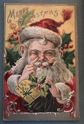 Santa Claus with Finger to Nose~Holly~Antique Gold Emboss Christmas Postcard-g84