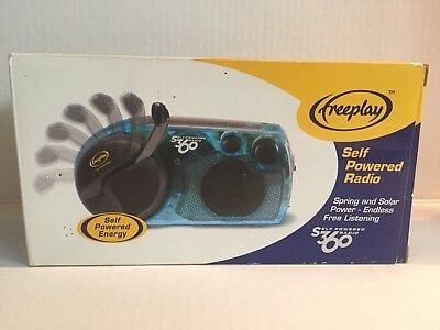 Freeplay Self Powered & Solar Radio Wind Up Blue Transparent NEW in BOX S360