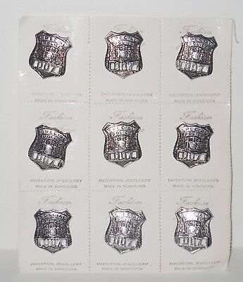 007 James Bond/Special Police 007 metal badges X 9 on retail/trade card. 1970's
