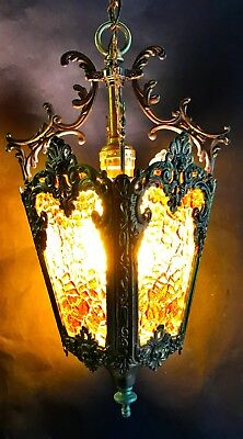 Vintage Ornate Brass Hanging Mid Century Light Fixture With Amber Glass Panels
