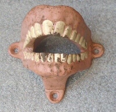 scarce old painted cast iron teeth wall mounted bottle opener