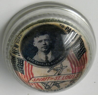 I have a May 21, 1927 Charles Lindbergh Spirit of St. Louis souvenir paperweight