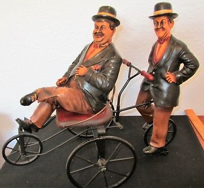 Vintage Laurel and Hardy Figures Riding on Bicycle For Two