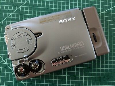 SONY WM-EX911 Wallkman Cassette Player with earphone attached Mint!!!