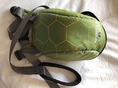 Little life child's rucksack with detachable reins. Green reptile design.