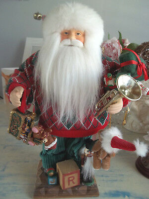 "16"" Vintage Santa Claus Christmas figure standing on the platform with toys"