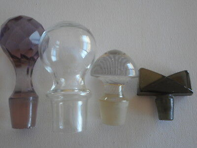 antique amethyst faceted glass stopper and 3 others, 1 smoky grey & 2 clear.