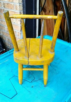 vintage child's yellow wooden doll chair