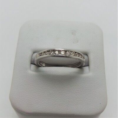 18ct WHITE GOLD  CURVED DIAMOND WEDDING RING VALUED @$1363 COMES WITH VALUATION