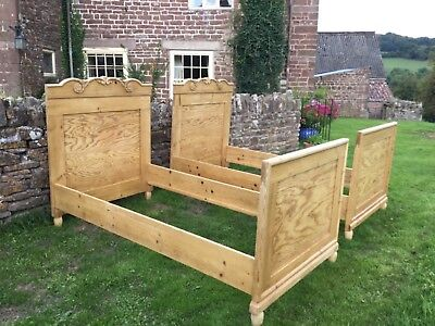 A pair of stunning single antique Dutch pine beds