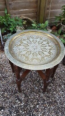 vintage folding table with brass charger ,