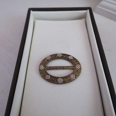 Small gilt oval belt buckle with enamel decoration c1920s-1930s