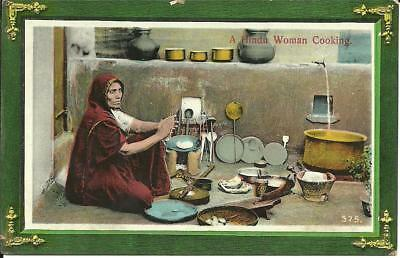 A HINDU WOMAN COOKING, INDIA (COLOUR PRINTED GLOSSY POSTCARD) c1910