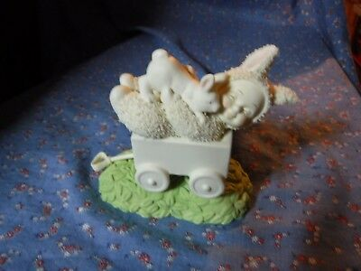 Snowbabies  Snowbunny Laying in Cart with Bunny  3 3/4 Inch high