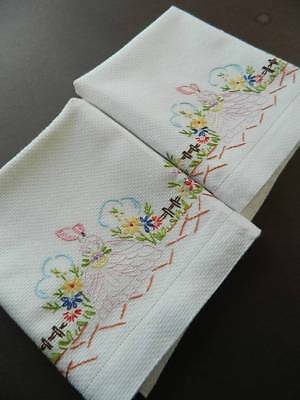 Pair vintage white huckaback towels - hand embroidered Crinoline Lady to each