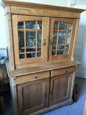 Stripped Pine Dresser with glass doors