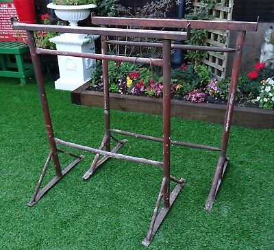 """A PAIR OF OLD HEAVY DUTY IRON BUILDERS TRESTLES. 38¾"""" wide by 40¼"""" high."""