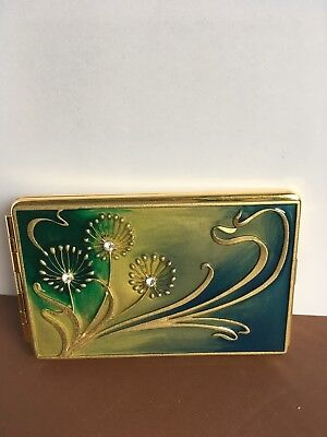 CARD CASE. Gold coloured case with colourful decorative design on front