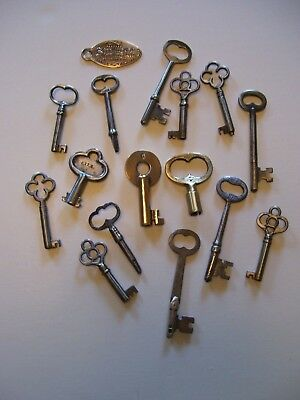 Lot Of Fifteen (15) Keys And One (1) Brass Tag.