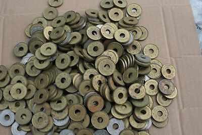 vintage one arm bandit tokens / slot machine tokens x 600  see photographs