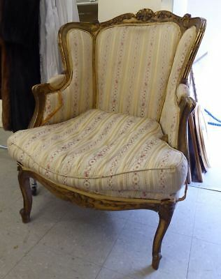Antique French gilt wing armchair with carved cabriole legs for re-upholstery