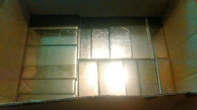 25 Bronze Robertson Tiles, made in USA.