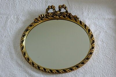 Gilt bow wall mirror with silvered glass
