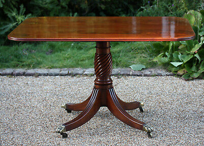 Antique Regency rectangular flame mahogany tilt-top pedestal breakfast table