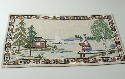 Vintage Swedish handembroidered tapestry, girl in blue national dress  by lake
