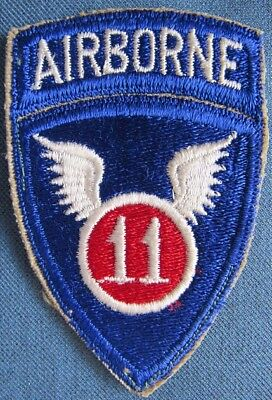 "WWII US Army 11th Airborne Division shoulder patch with attached ""AIRBORNE"" tab"