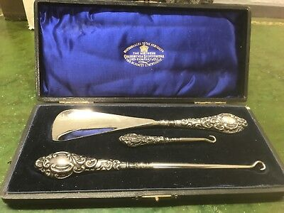 Silver handled 3 Piece set- Button hooks and shoe horn Broadway & Co Circa 1906